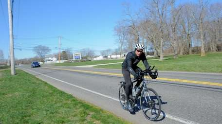 A bicyclist on Sound Avenue in Baiting Hollow