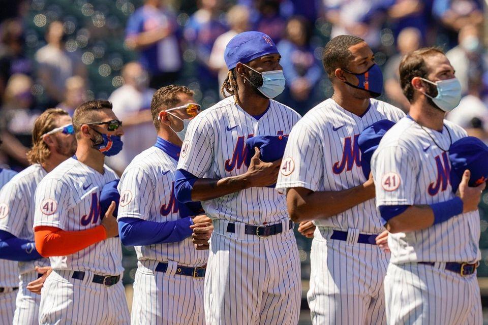 New York Mets relief pitcher Miguel Castro, center,