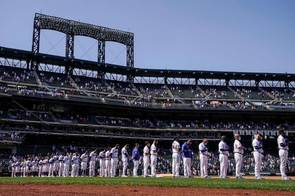 The New York Mets stand for pre-game ceremonies