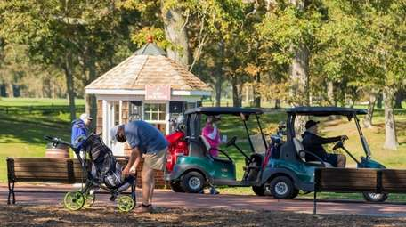 Golfers wait to tee off on the Red