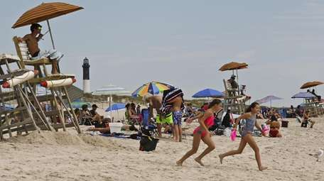 Lifeguards watch over beach-goers at Robert Moses State