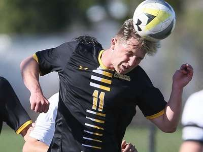 Commack's Tommy Wagner (11) heads the ball in