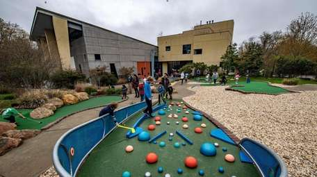 Have a ball playing miniature golf at the