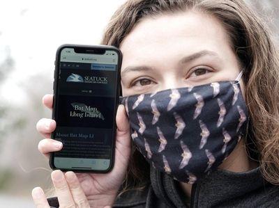 Emily Hall displays the BatMap Long Island app,