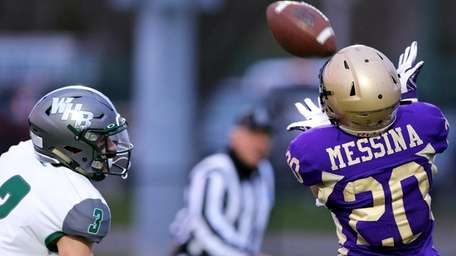 Sayville WR CJ Messina grabs the pass, and
