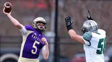 Sayville QB Jack Cheshire gets the pass off