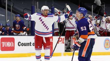 K'Andre Miller #79 of the Rangers celebrates his