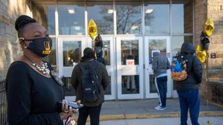 Uniondale acting Superintendent Rhonda Taylor greets ninth-graders returning