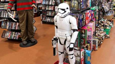 A video showing two women taking a3-foot-tall stormtrooperthat