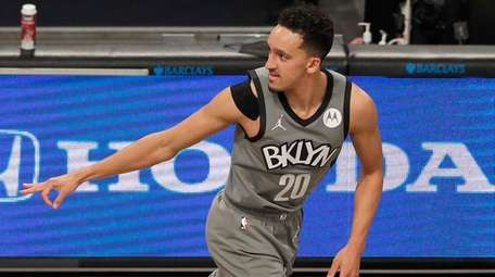 Landry Shamet #20 of the Brooklyn Nets reacts