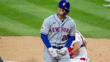 Mets left fielder J.D. Davis (28) reacts after