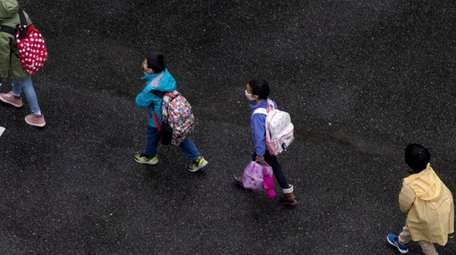 Children are socially distanced as they walk into