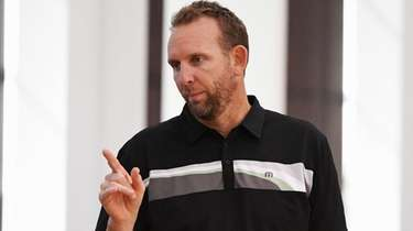 Nets general manager Sean Marks looks on during