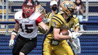 Bethpage's Brian Luzzy (19) picks off the Plainedge
