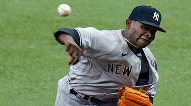 Yankees starting pitcher Domingo German delivers to the