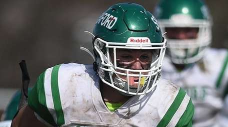 James McHugh #1 of Seaford rushes for a