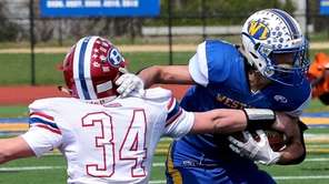 West Islip WR Ryan Behrens sidesteps the tackle