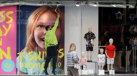 Final touches are made to a window display