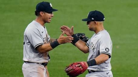 Yankees second baseman Rougned Odor, right, celebrates with