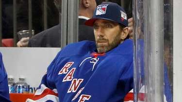 Then-Rangers goaltender Henrik Lundqvist looks on from the
