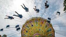 Thrill seekers try out the Wave Swing at