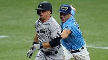 The Yankees' Brett Gardner, left, gets tagged out