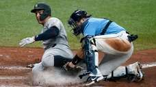 Aaron Judge is thrown out at home as