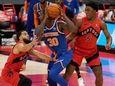 Knicks forward Julius Randle tries to work betwee