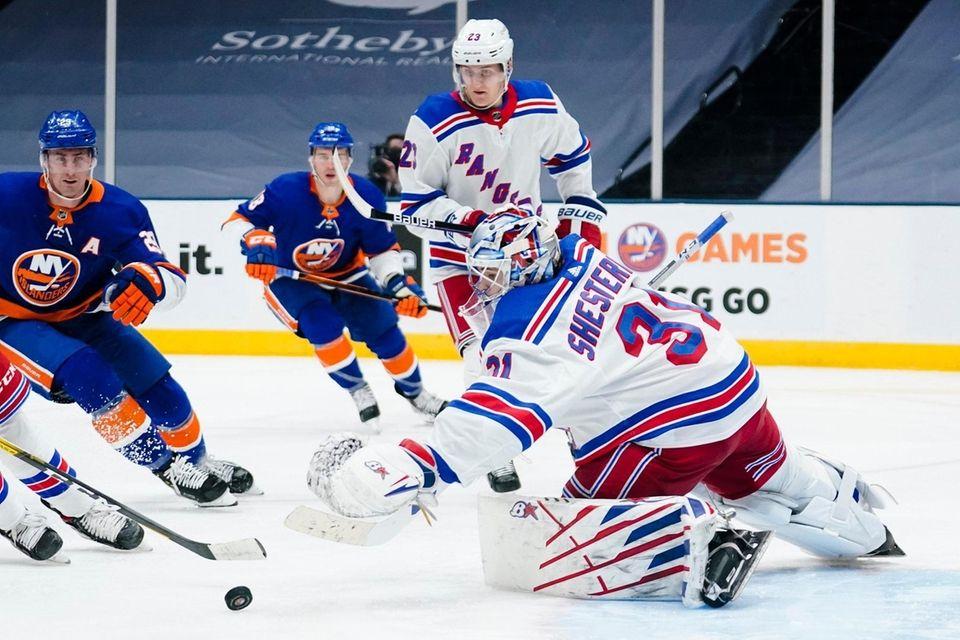 Rangers goaltender Igor Shesterkin reaches for the puck
