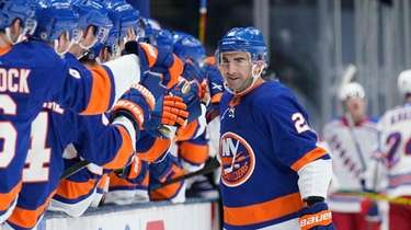 The Islanders' Kyle Palmieri (21) celebrates with teammates