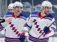 The Rangers' Brendan Smith, right, and Libor Hajek,