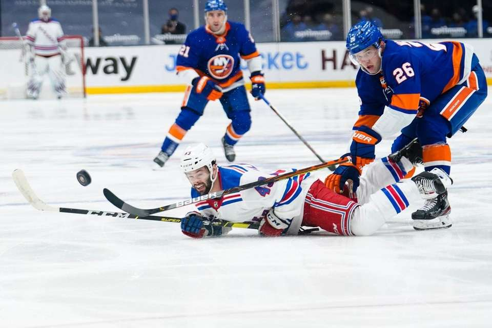 The Rangers' Colin Blackwell (43) fights for control