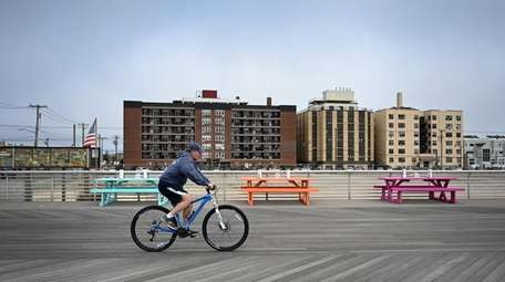 A biker rides down an empty Long Beach