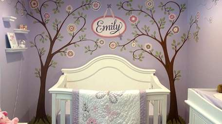 A mural in a baby girl's room designed