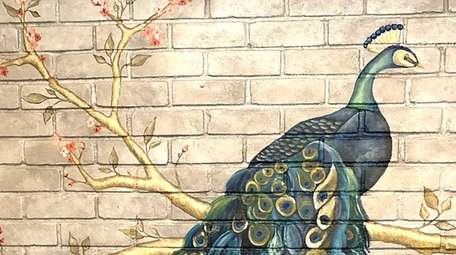 Greenfield did this peacock mural for a living