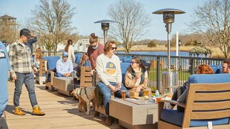 Patrons enjoy outdoor dining, Peconic County Brewing, Riverhead,
