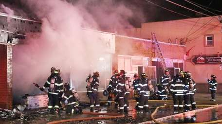 Firefighters from multiple area departments battled an early-morning