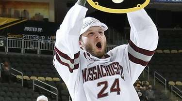 Zac Jones of the Massachusetts Minutemen celebrates with