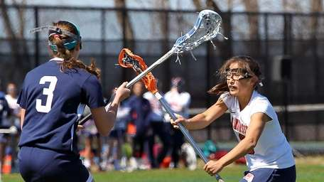 Manhasset's Sarah Barcia #3, shoots and scores against