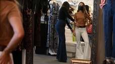 Gabrielle Banschick, left, owner of Penelope, helps style