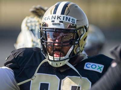Then-Saints defensive tackle Sheldon Rankins stretches during training