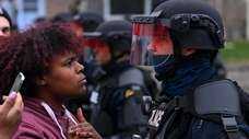 A demonstrator protests the fatal police shooting of