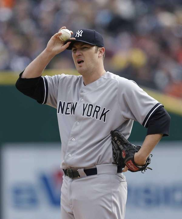 New York Yankees starting pitcher Phil Hughes reacts