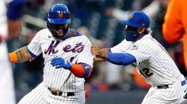 Jonathan Villar #1 of the Mets celebrates his