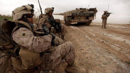 U.S. Marines patrol a road in 2010 as