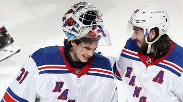 Igor Shesterkin #31 and Mika Zibanejad #93 of