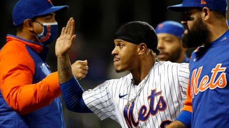 Marcus Stroman #0 of the Mets celebrates after