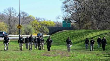 About 100 Nassau County police officers searched wooded