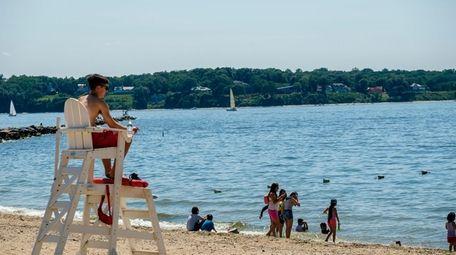 A lifeguard keeps an eye on bathers on