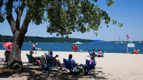 Visitors find some shade at Theodore Roosevelt Memorial